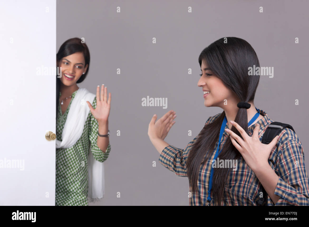 Elder sister saying bye to younger sister - Stock Image