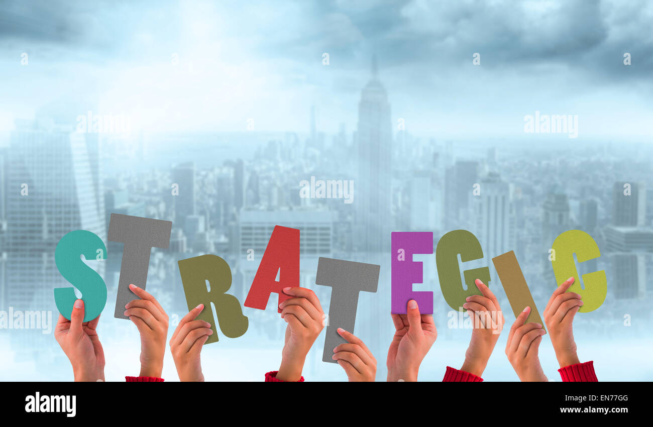 Composite image of hands holding up strategic - Stock Image