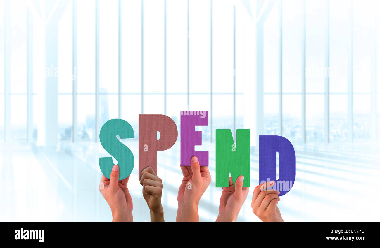 Composite image of hands holding up spend - Stock Image
