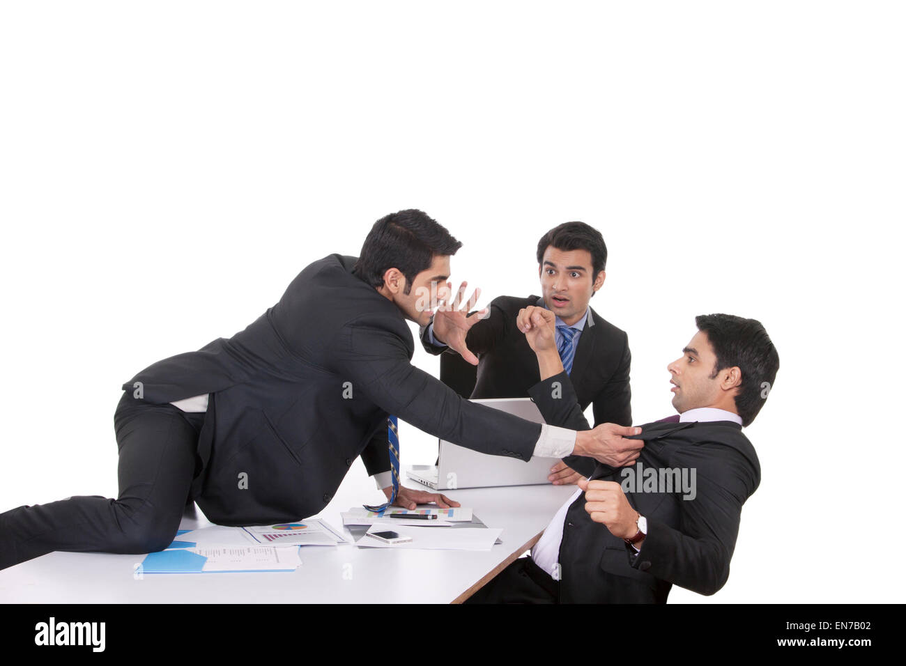 Businessman getting violent with fellow businessman - Stock Image