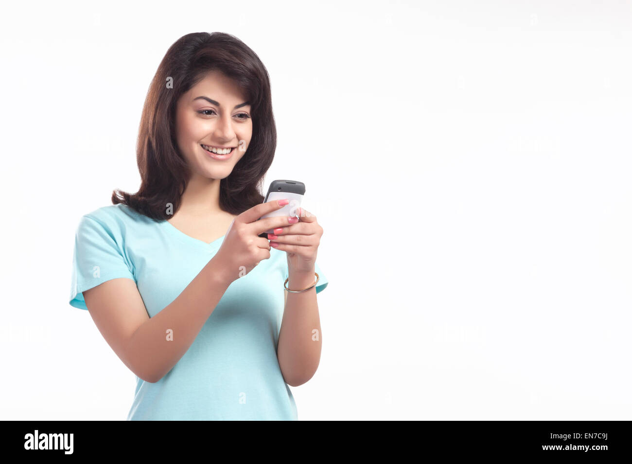 Woman reading an sms on a mobile phone - Stock Image