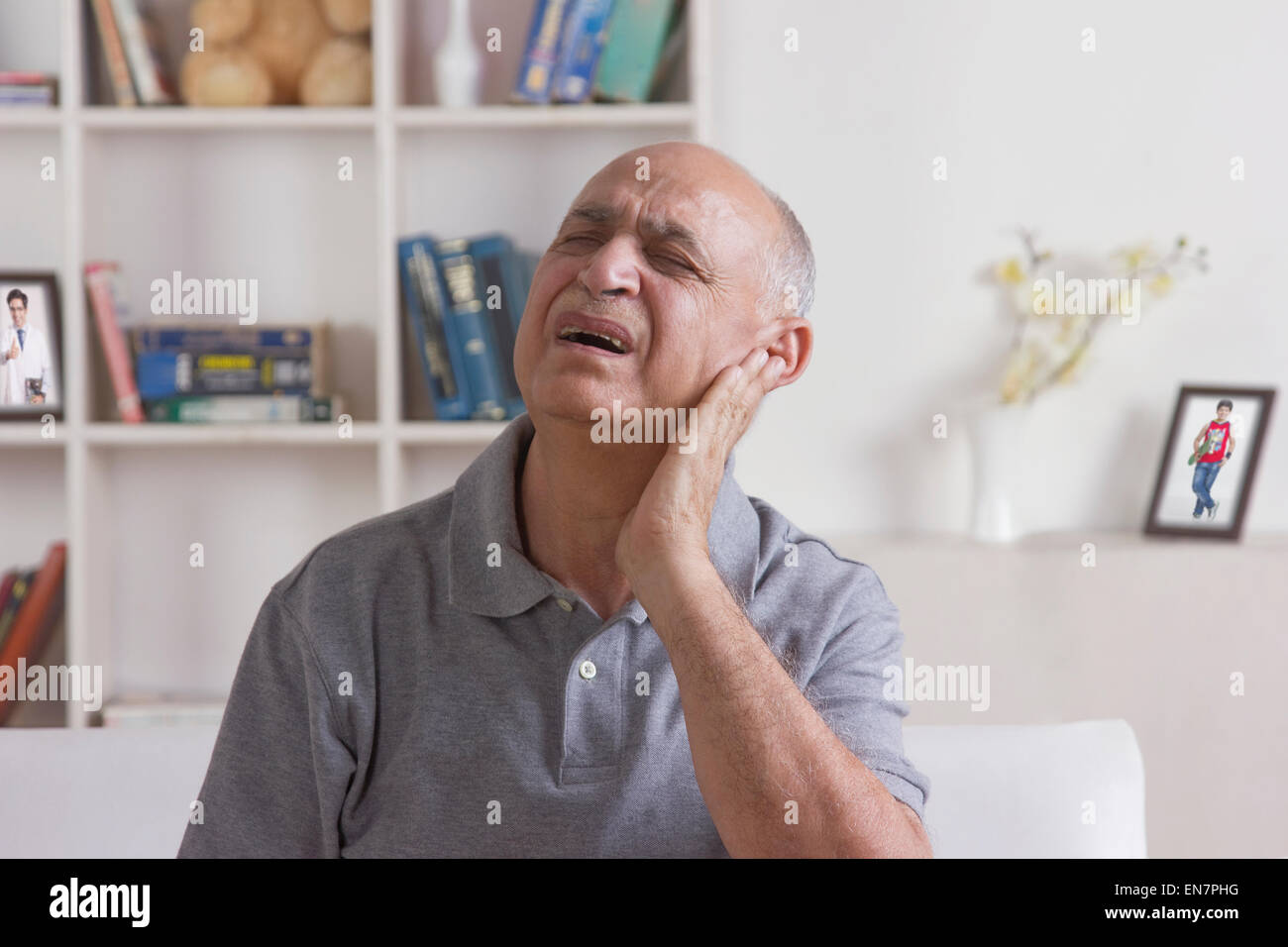 Old man with pain in ear - Stock Image
