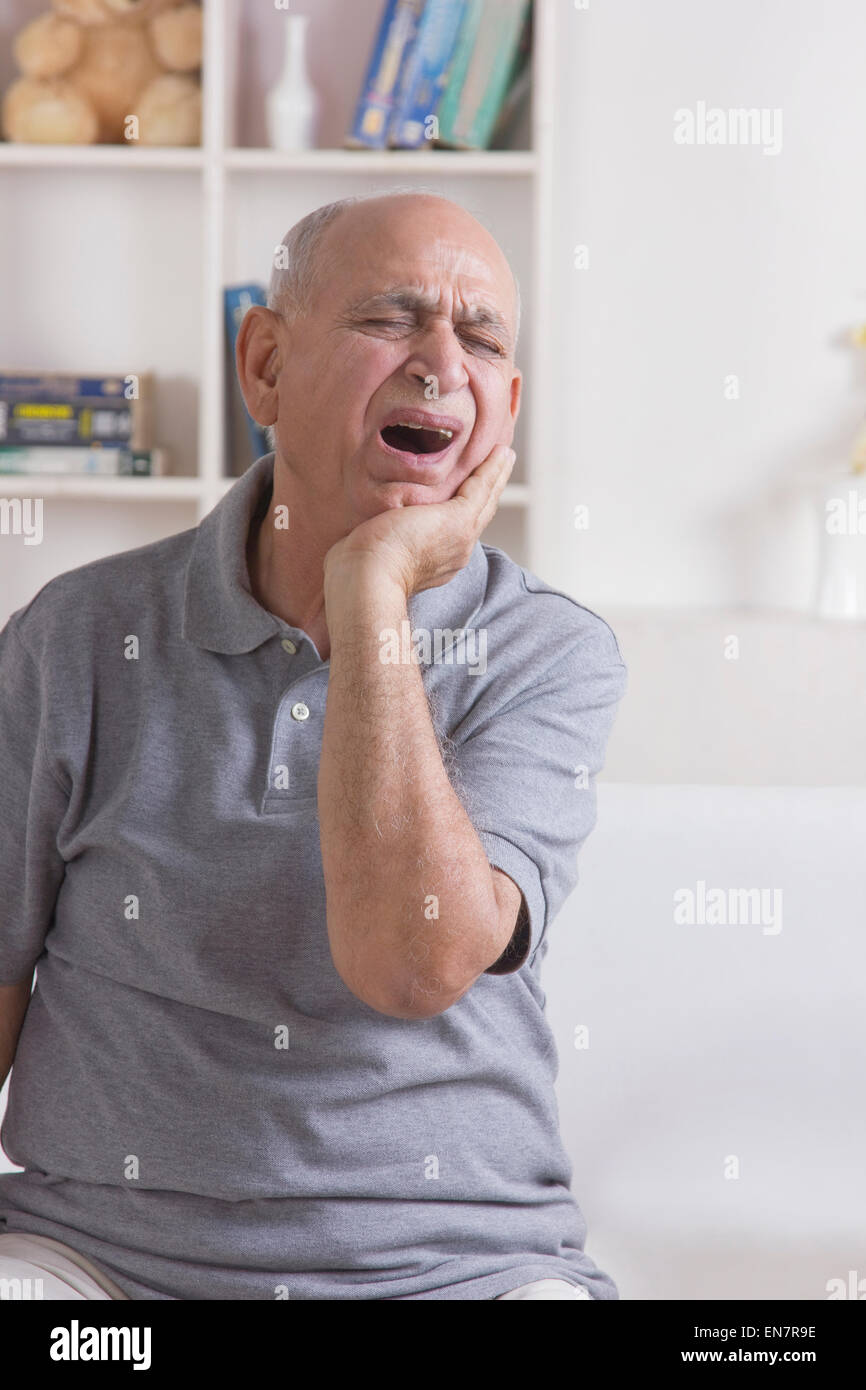 Old man with tooth ache - Stock Image