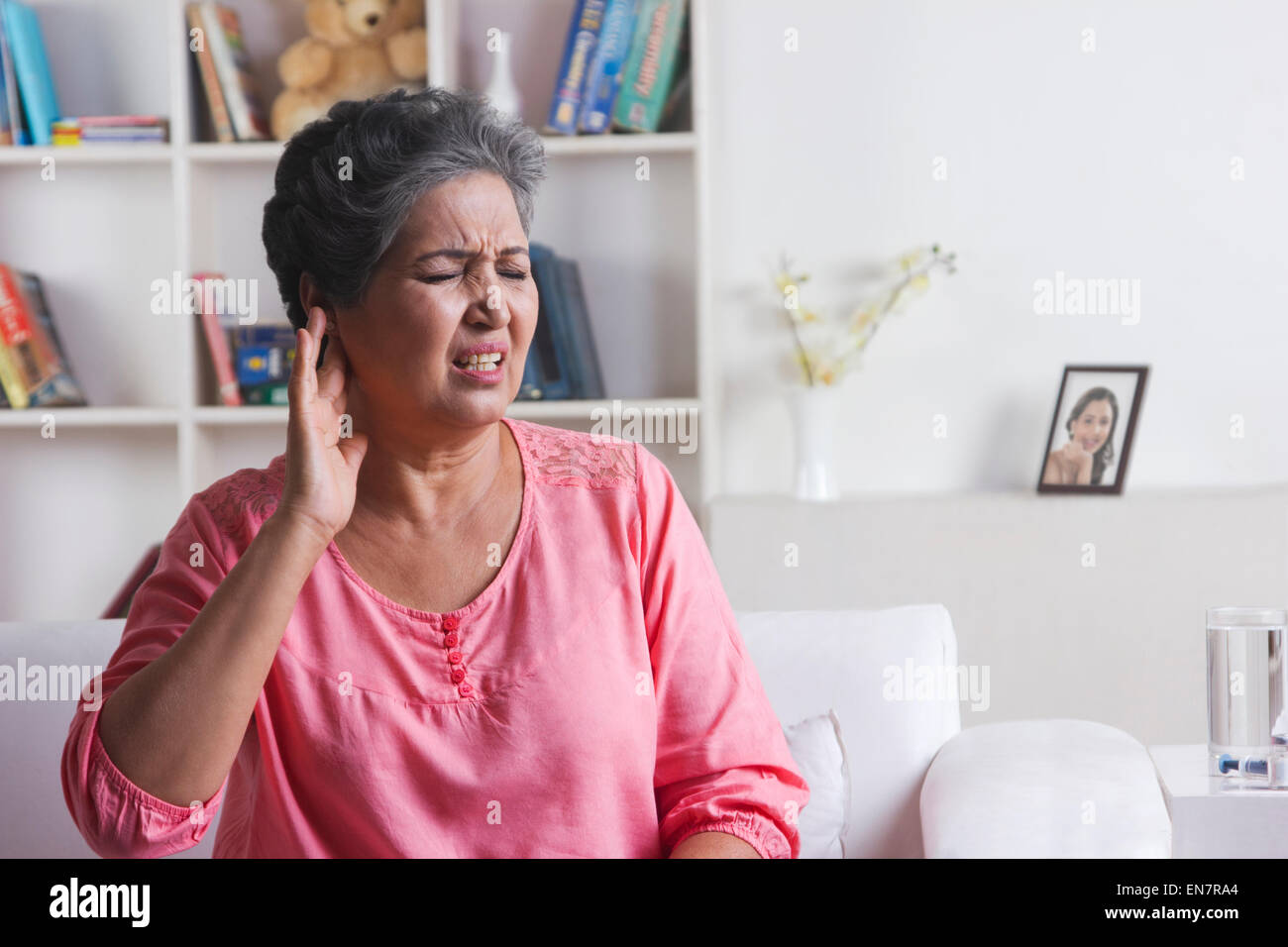 Old woman with pain in ear - Stock Image