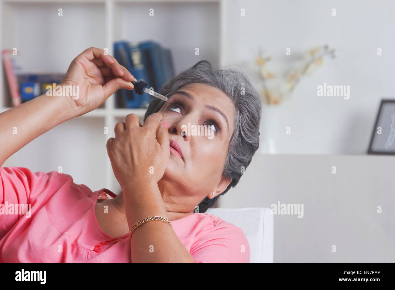 Old woman putting eye drops Stock Photo: 81921233 - Alamy