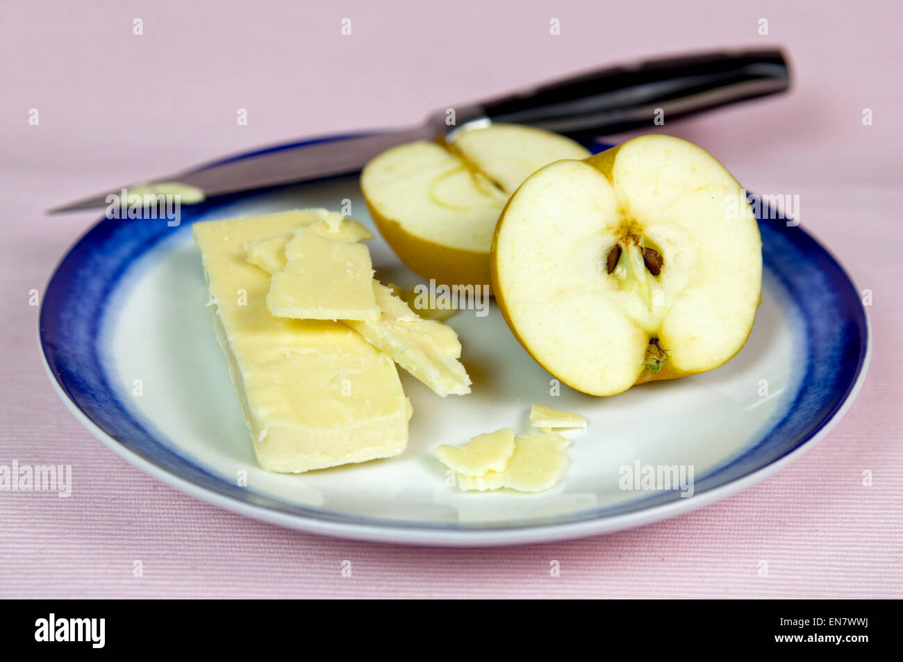 Egremont russet apples with cheese on plate. Egremont russet apples are an old fashioned English apple dating back - Stock Image