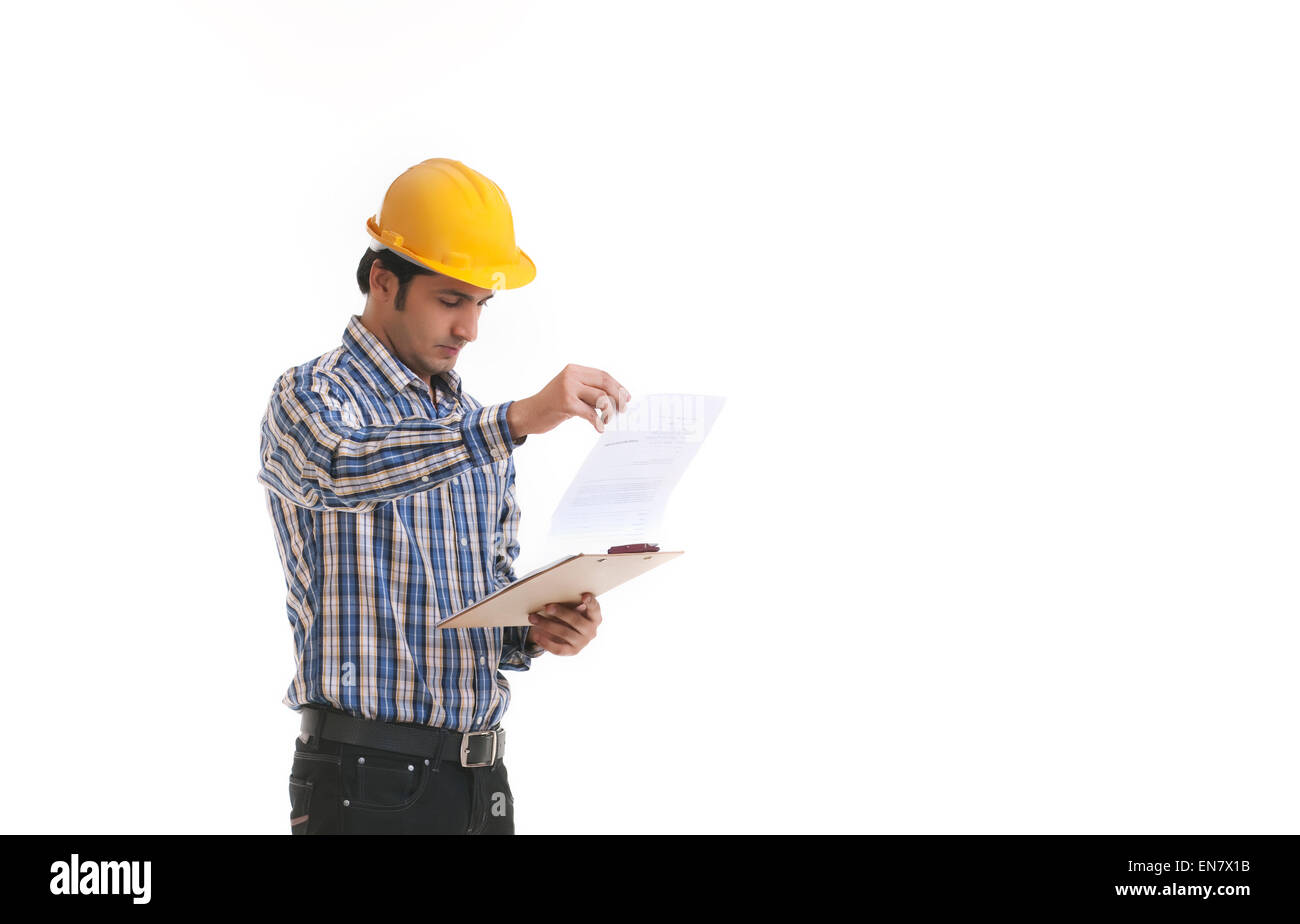 Contractor looking at blueprint - Stock Image