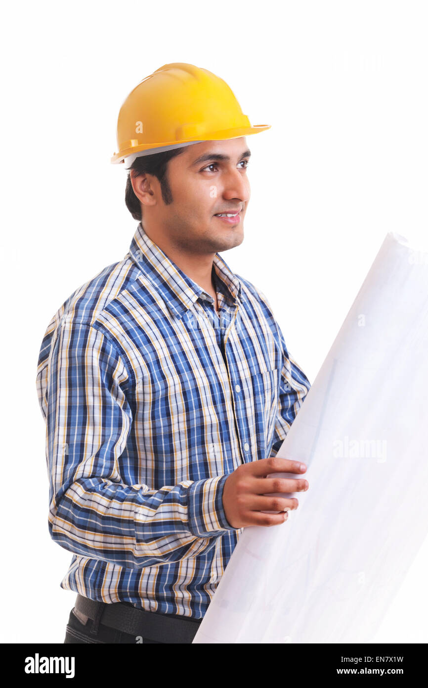Portrait of smiling contractor holding blueprint - Stock Image