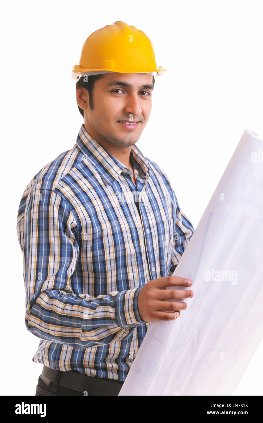 Portrait of smiling contractor holding blueprint Stock Photo