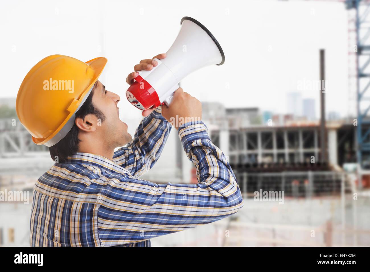 Building Contractor shouting through megaphone - Stock Image