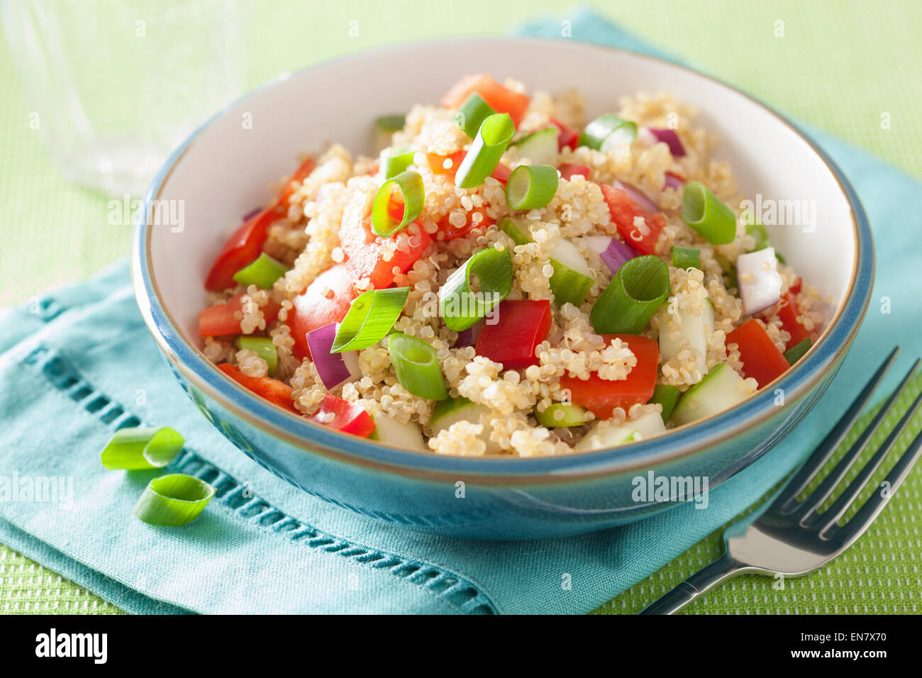 healthy couscous salad with tomato cucumber onion chives - Stock Image