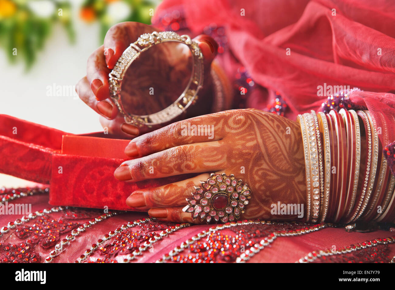 Close-up of a Brides hands holding bangle - Stock Image