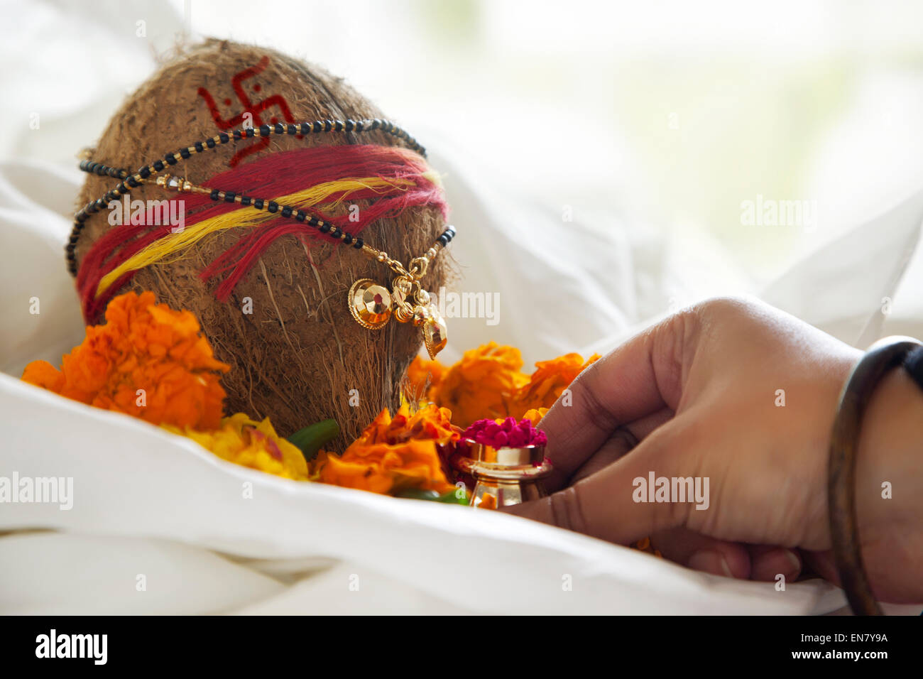 WoMans hand performing rituals - Stock Image