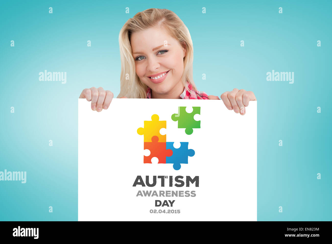 Composite image of woman beaming while holding a blank sign - Stock Image
