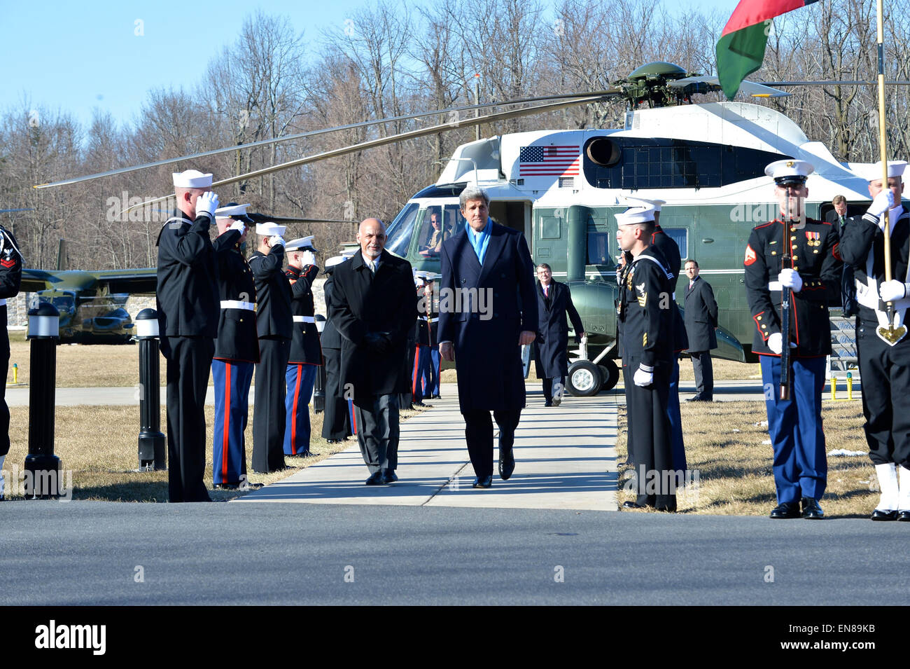 U.S. Secretary of State John Kerry escorts Afghan President Ashraf Ghani past a military honor guard as they arrive - Stock Image