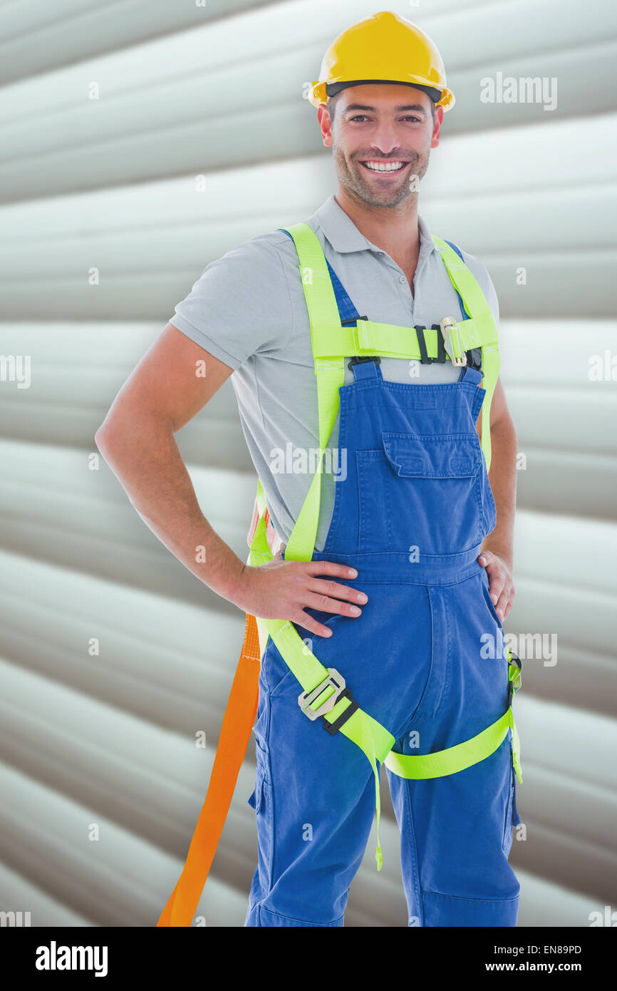 Composite image of builder in safety gear - Stock Image
