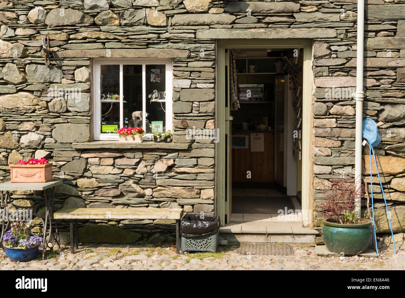 ROSTHWAITE, BORROWDALE, LAKE DISTRICT, CUMBRIA, ENGLAND, UK - 9 APRIL 2015: Entrance to Flock-in walkers Tea Room, - Stock Image