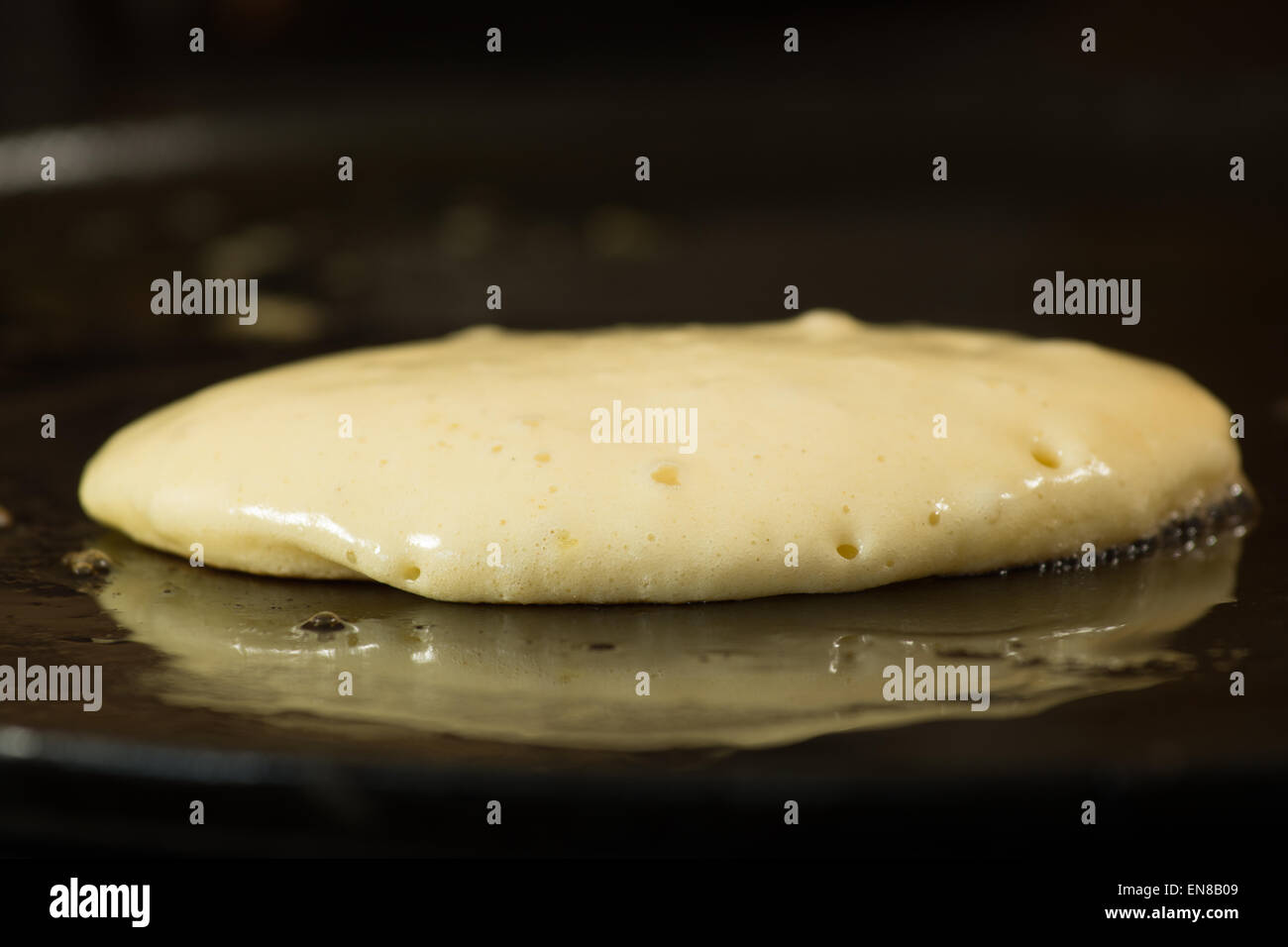 making a fluffy american/scotch style pancake - batter just beginning to rise Stock Photo