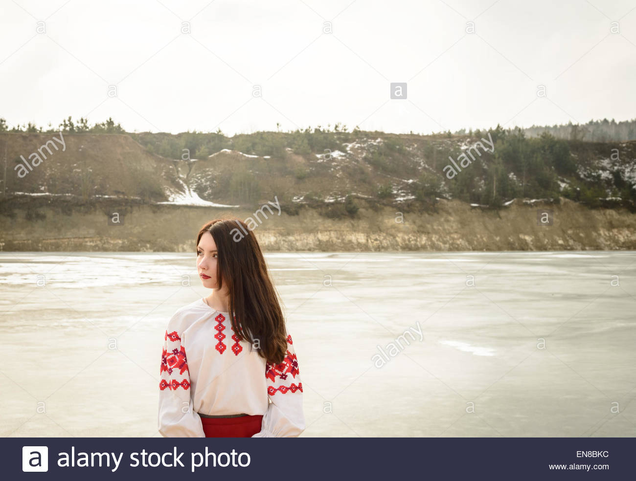 young woman in a Slavic Belarusian national original suit outdoors - Stock Image