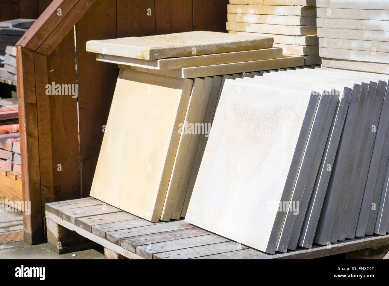 New paving slabs stacked on a pallet ready for sale, UK. - Stock Image