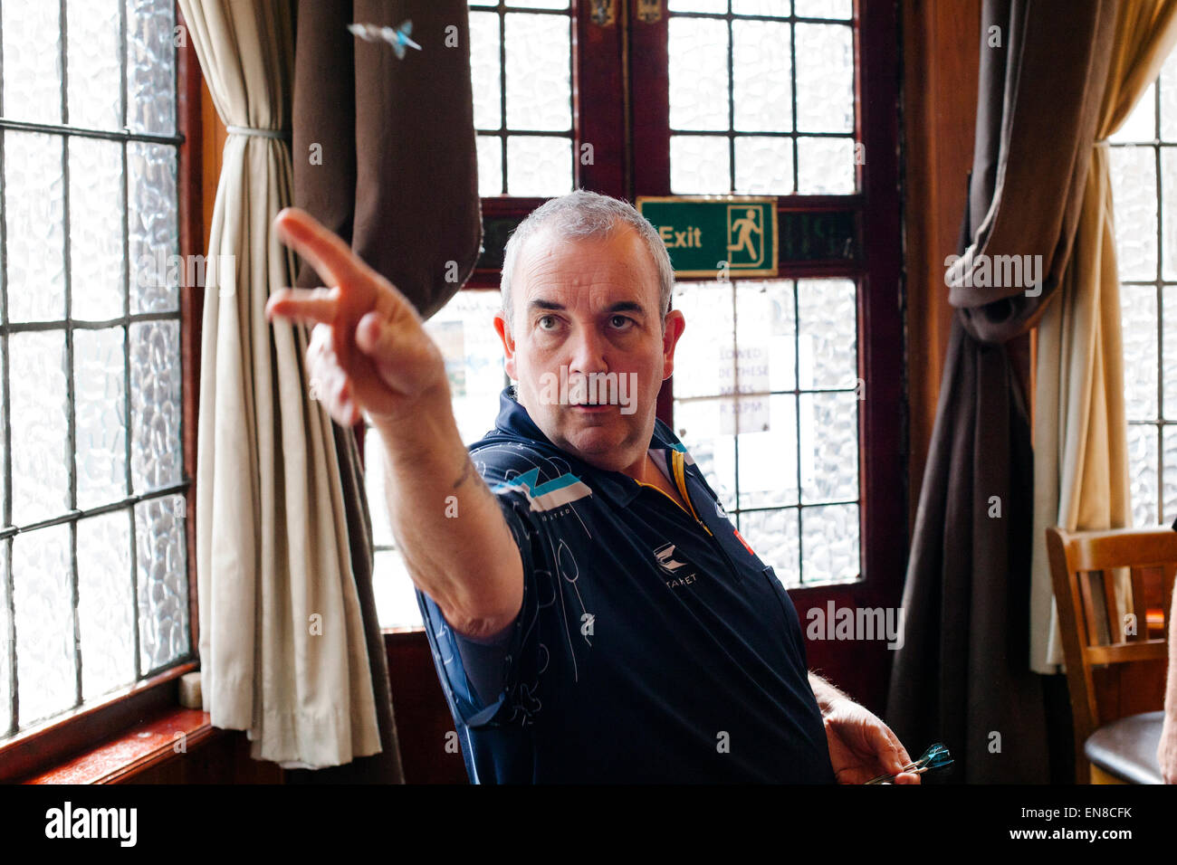 Phil 'The Power' Taylor, 16x world darts champion training in London. - Stock Image