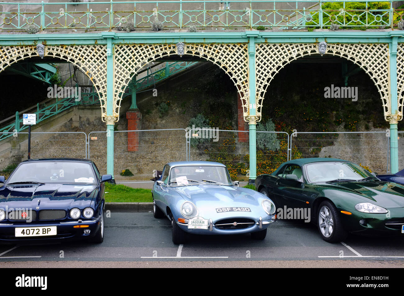 Classic Jaguars parked along Madeira Drive in Brighton for a car show. - Stock Image