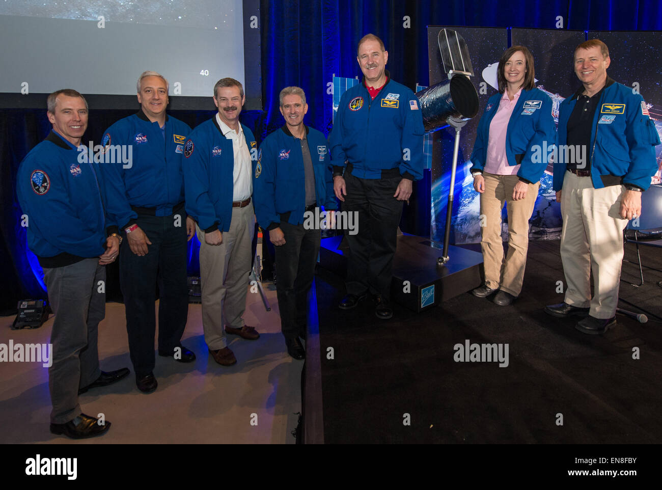 The crew of STS-125, the final Hubble Servicing Mission, pose for a picture at the conclusion of a panel discussion - Stock Image