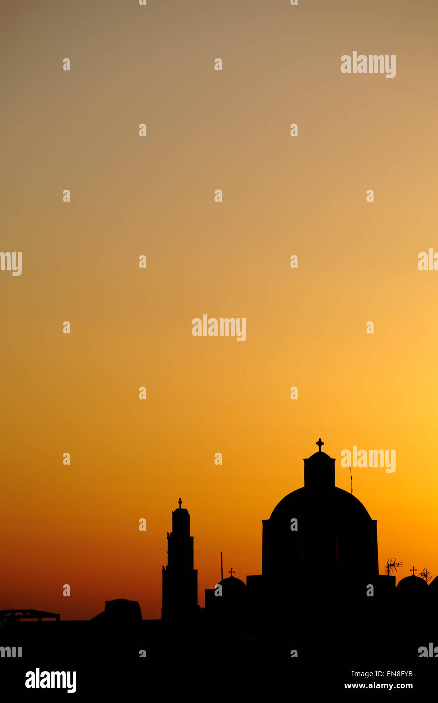 Silhouette of Orthodox Church in Santorini, Greece - Stock Image