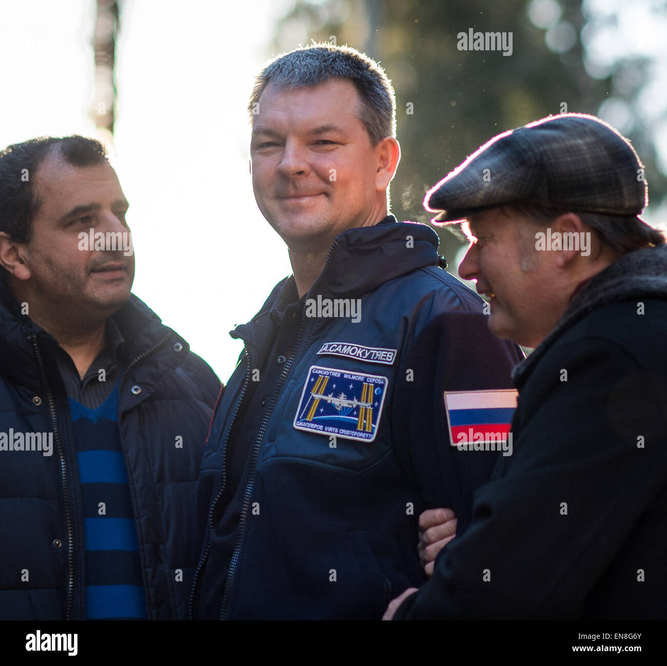 Expedition 42 Cosmonaut Alexander Samokutyaev of the Russian Federal Space Agency (Roscosmos), center, who returned - Stock Image