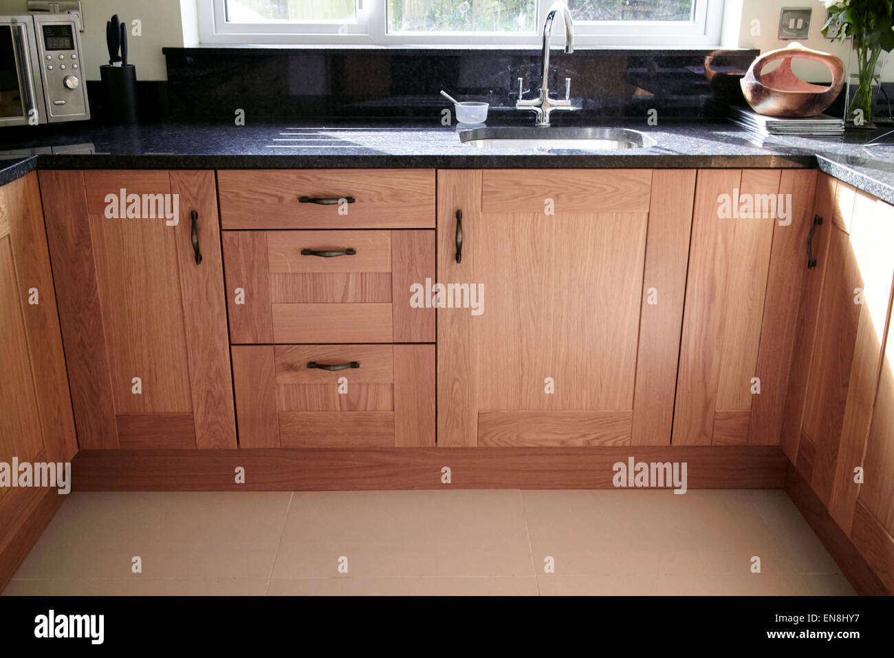brand new kitchen cabinets and granite worktops in a new build property in the uk Stock Photo