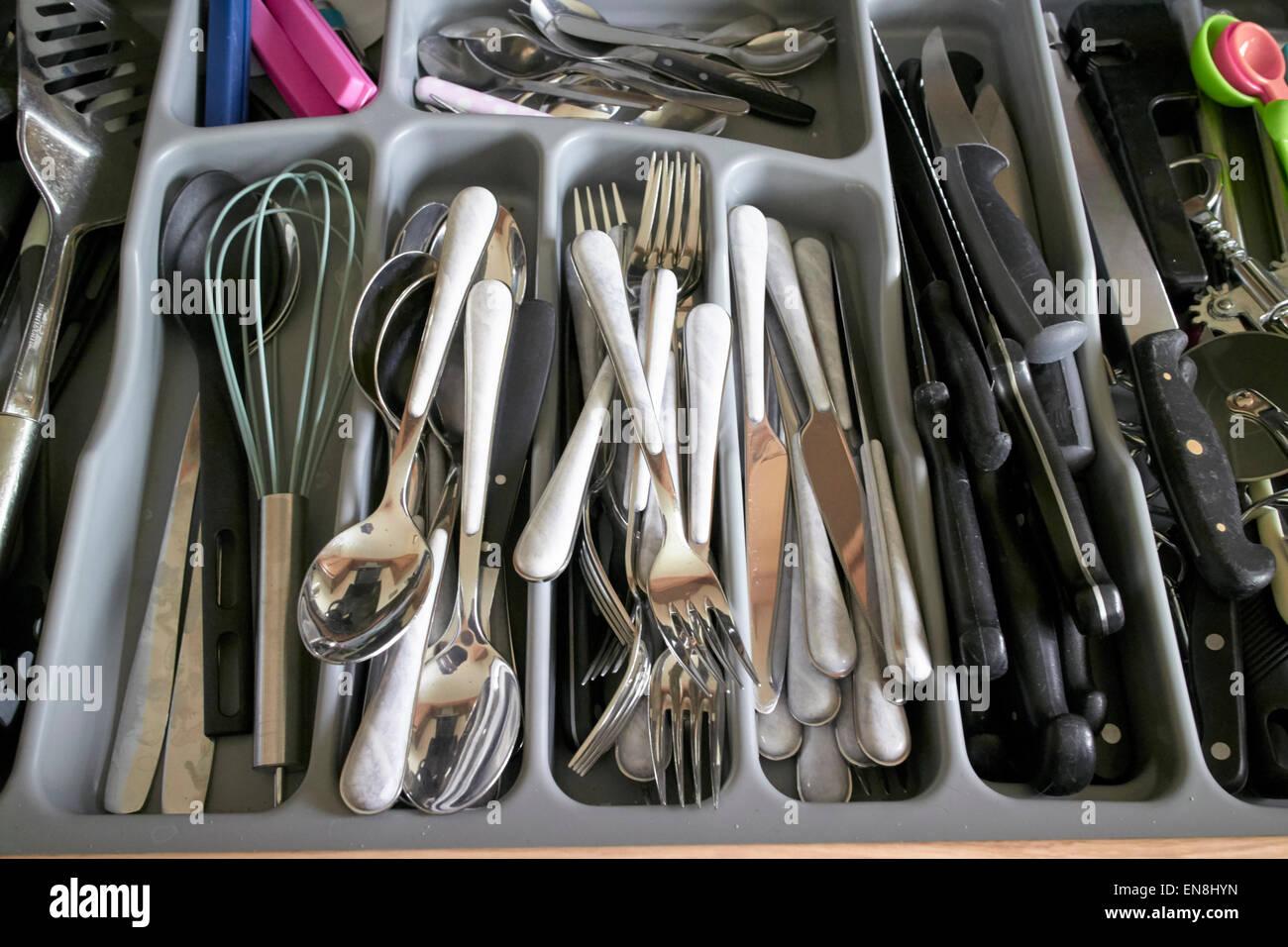cutlery drawer full of utensils - Stock Image