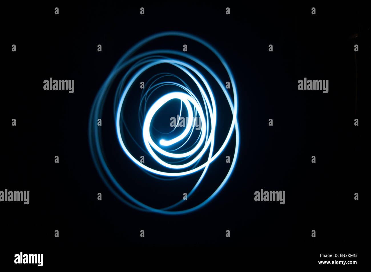 Light trails photography with long exposure technique. Photograph representing irregular light circles - Stock Image