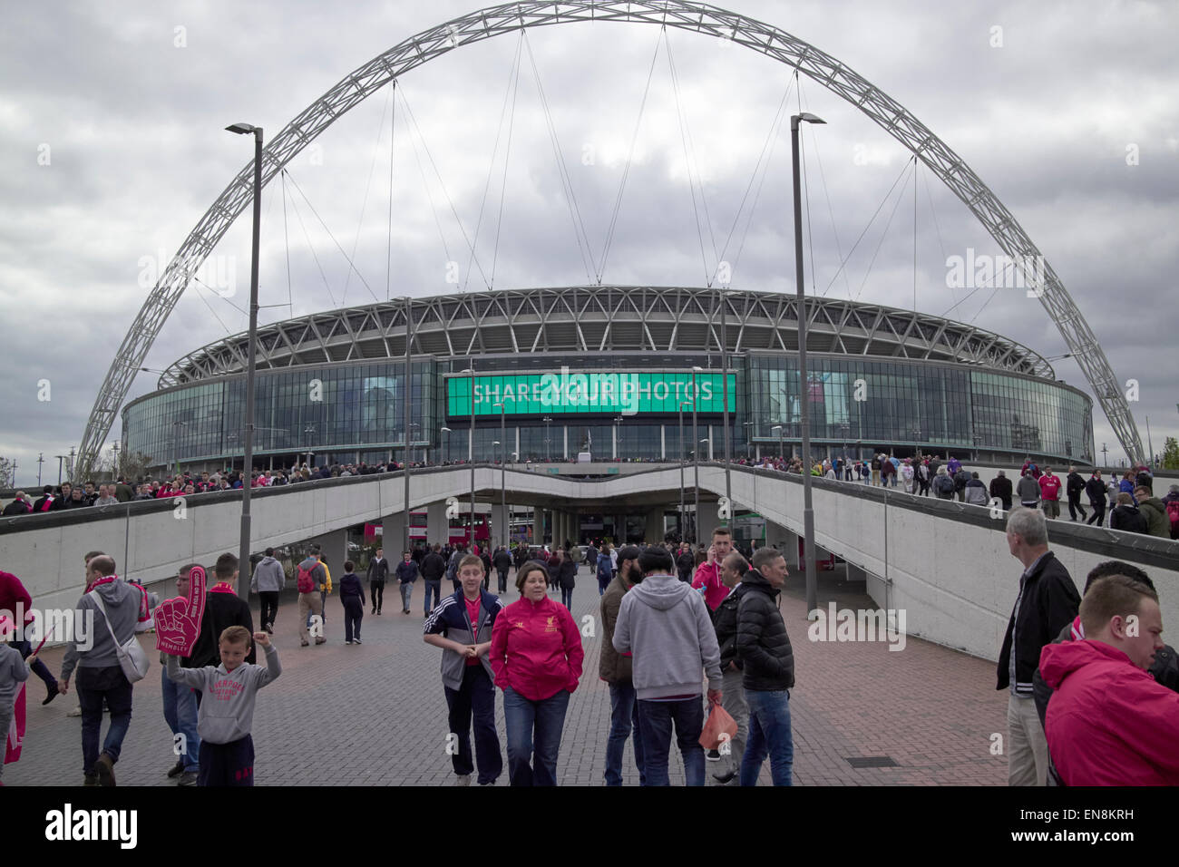 liverpool fans approach Wembley stadium on fa cup semi final day London UK - Stock Image