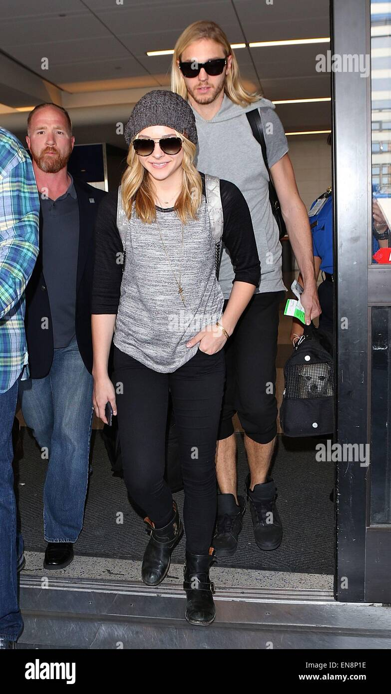 9048a503f9d Chloe Grace Moretz arrives at Los Angeles International (LAX) airport  Featuring  Chloe Moretz
