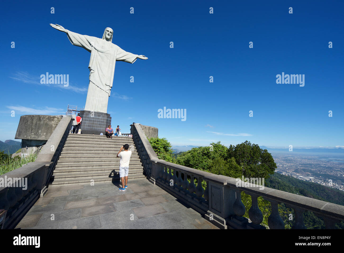RIO DE JANEIRO, BRAZIL - MARCH 05, 2015: The first group of tourists arrive at the Statue of Christ the Redeemer Stock Photo