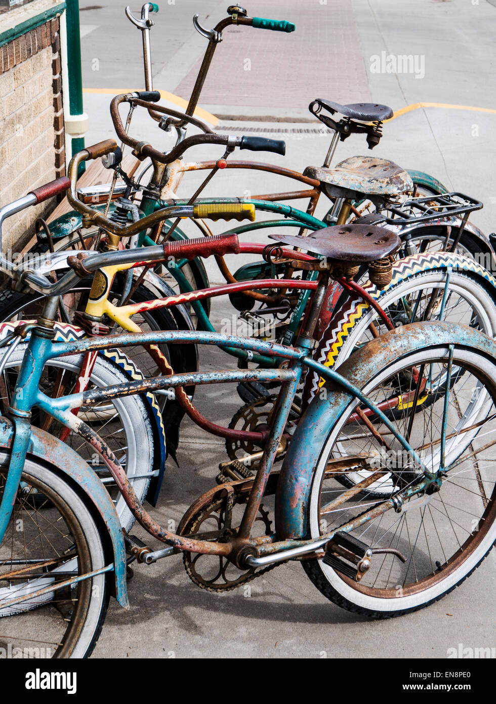 Old antique bicycles parked outside Salida Bike Company, downtown historic Salida, Colorado, USA - Stock Image