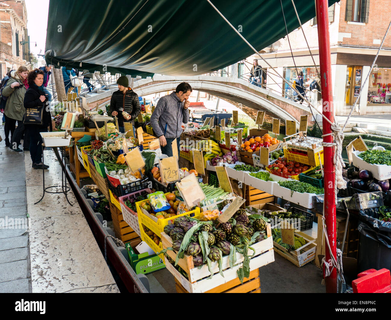 Vendor displays fresh fruit & vegetables on market boat, Venice, Italy, City of Canals - Stock Image