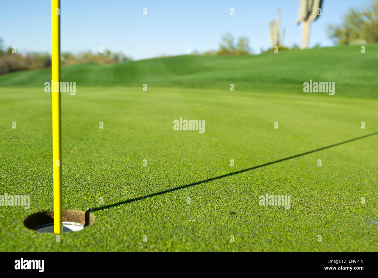 Close up of a golf hole on the fairway of a southwestern desert - Stock Image
