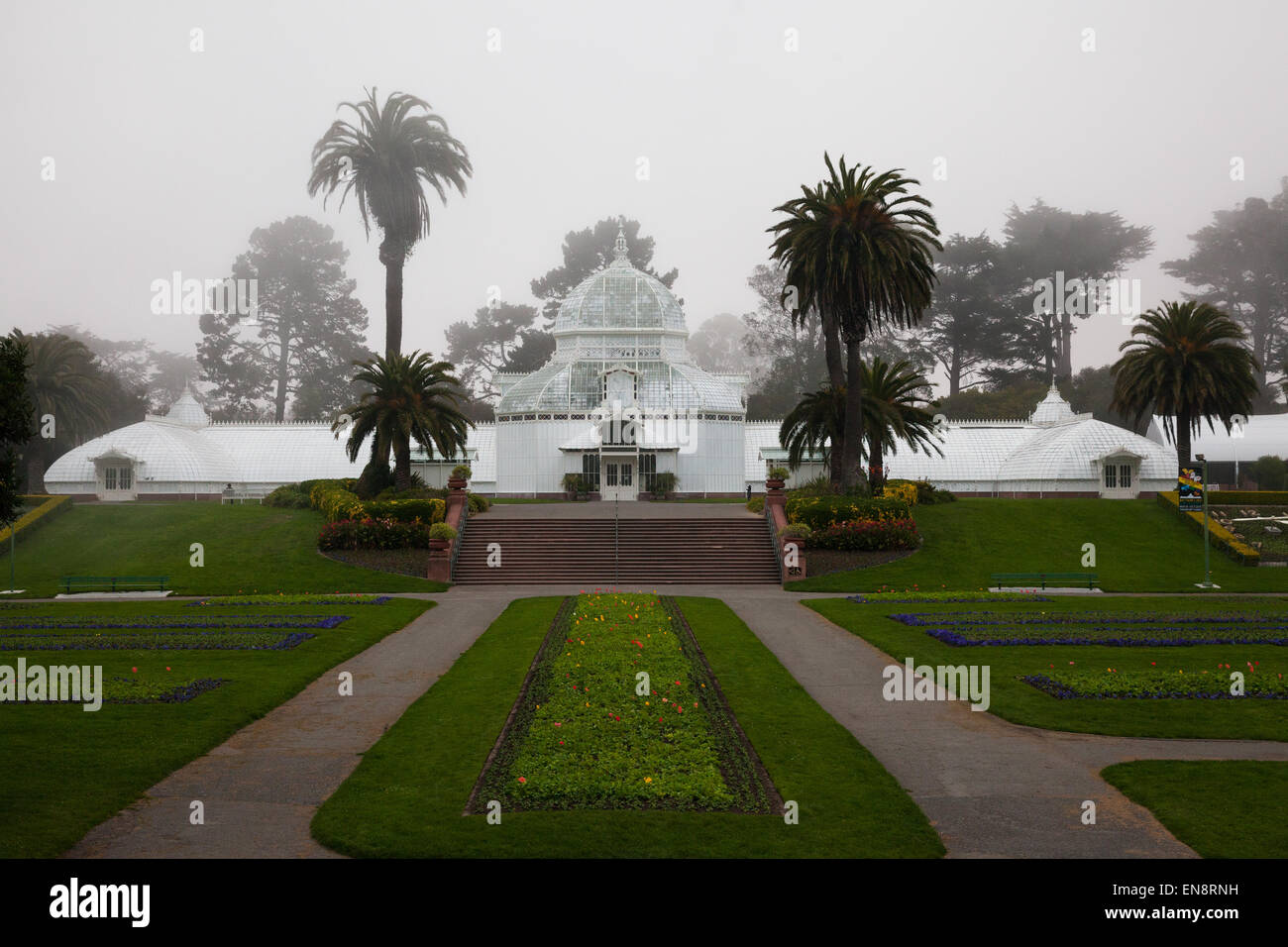 The Conservatory of Flowers in Golden Gate Park in San Francisco California on a foggy day. - Stock Image