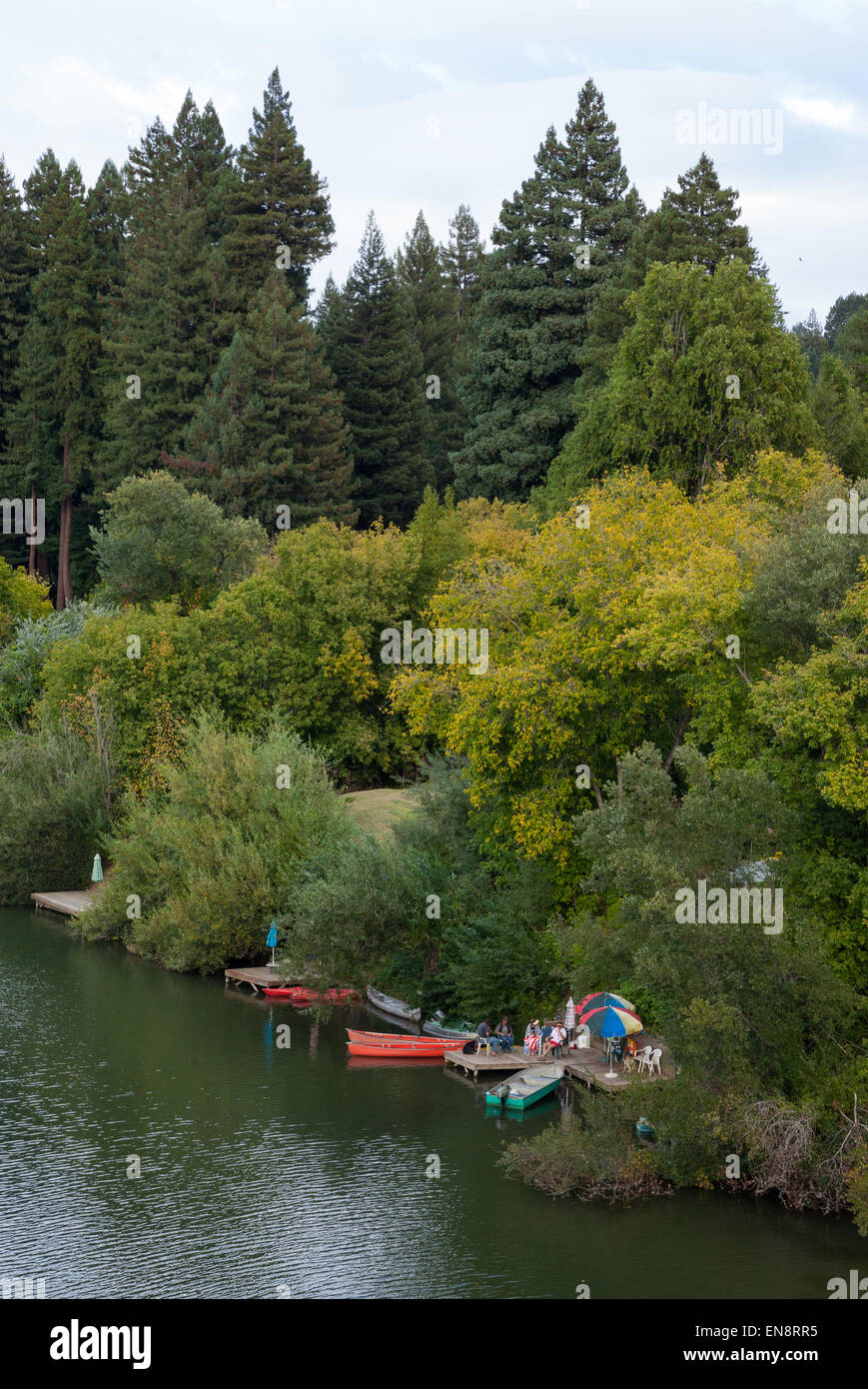 A private dock on the Russian River near Guernville in Northern California. - Stock Image