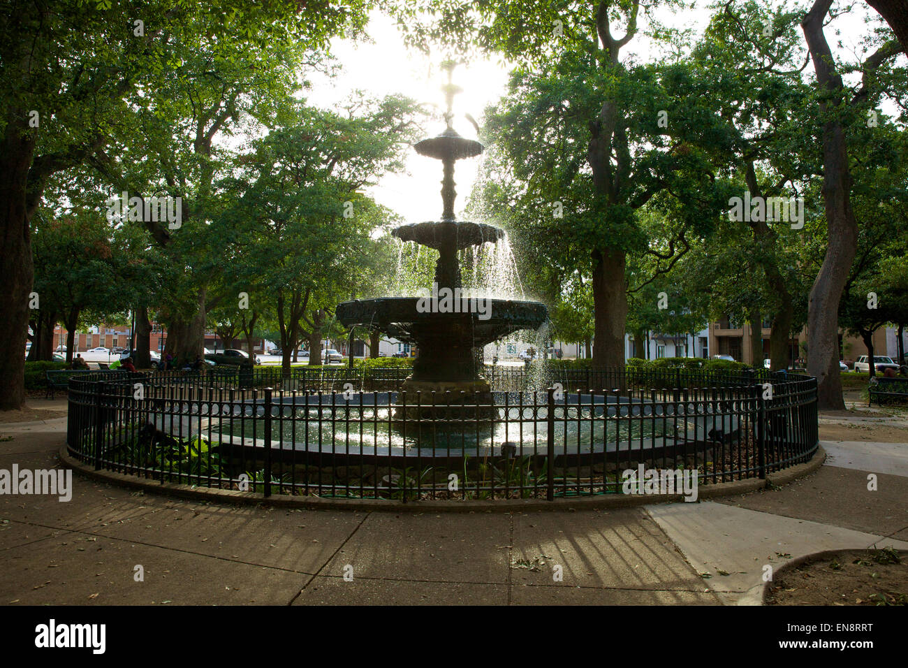 Water flowing in the fountain in the Bienville Square City Park in downtown Mobile, Alabama in the afternoon sunlight. - Stock Image