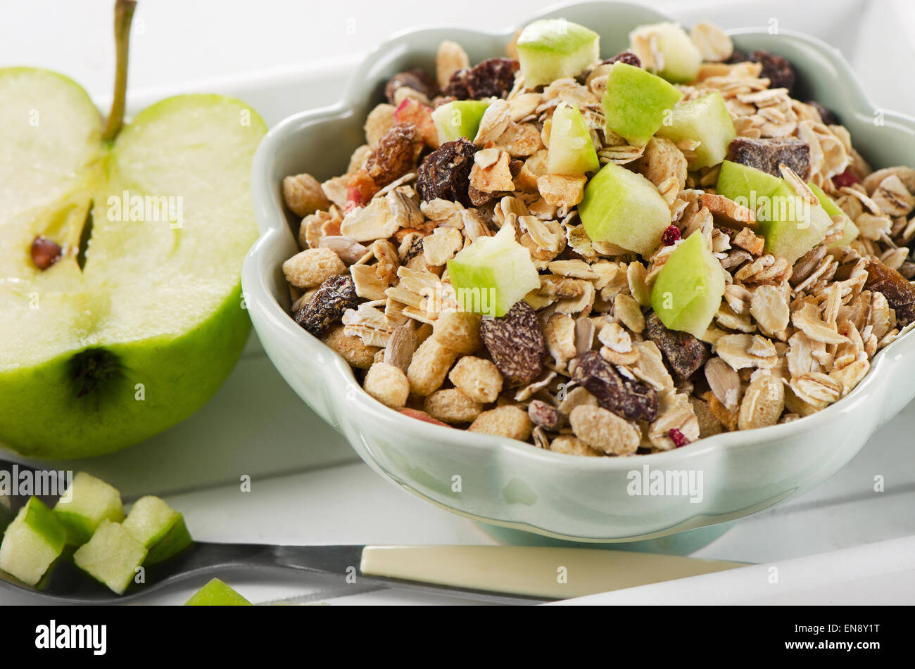 Healthy bowl of muesli, green apple for a nealthy breakfast - Stock Image