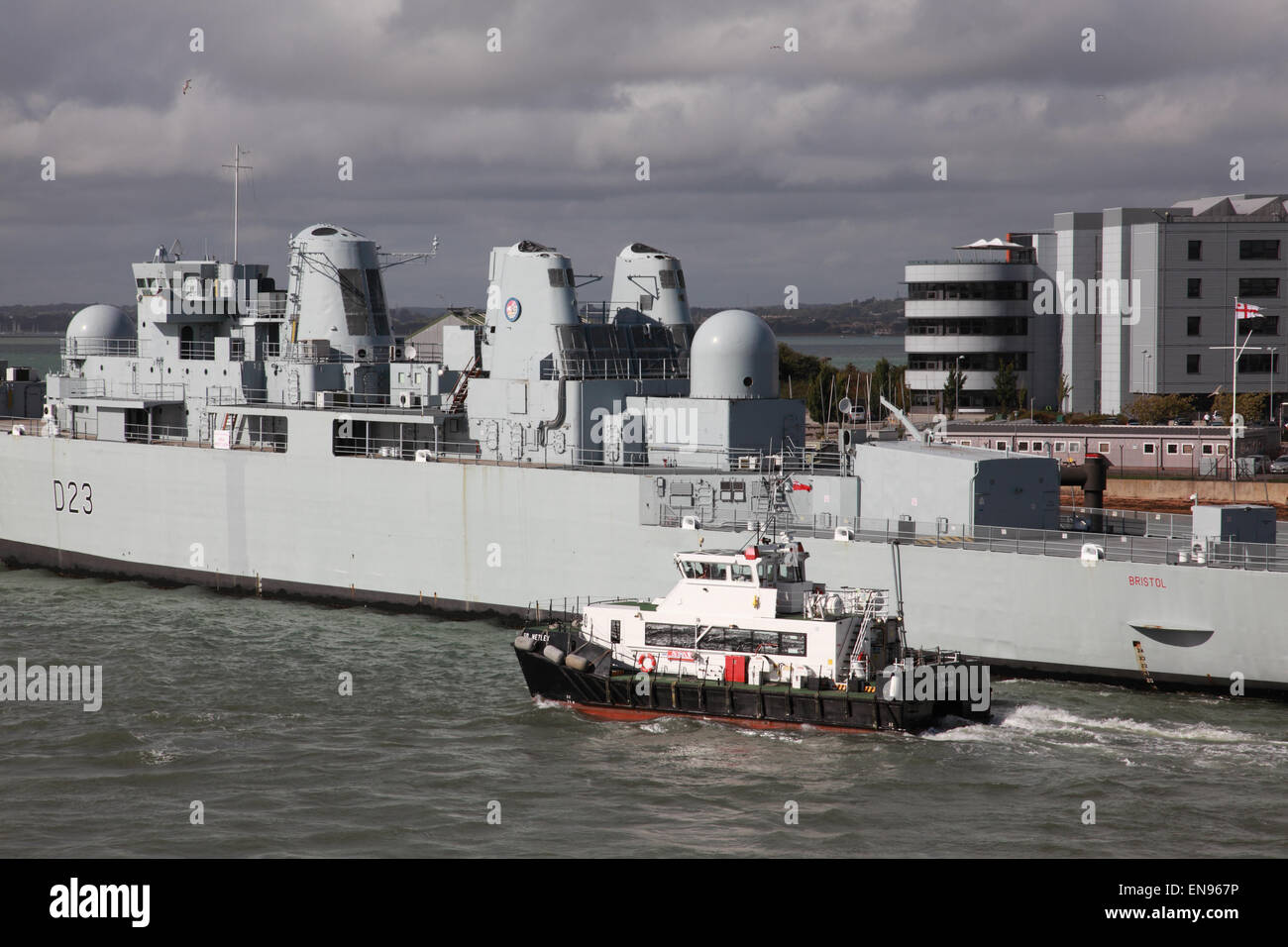 Port tender ship SD Netley and D23 HMS Bristol in Portsmouth Harbour, Hampshire, England, UK - Stock Image