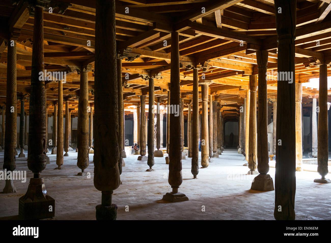 Uzbekistan, Khiva, the wood columns of the old Juma mosque inside - Stock Image