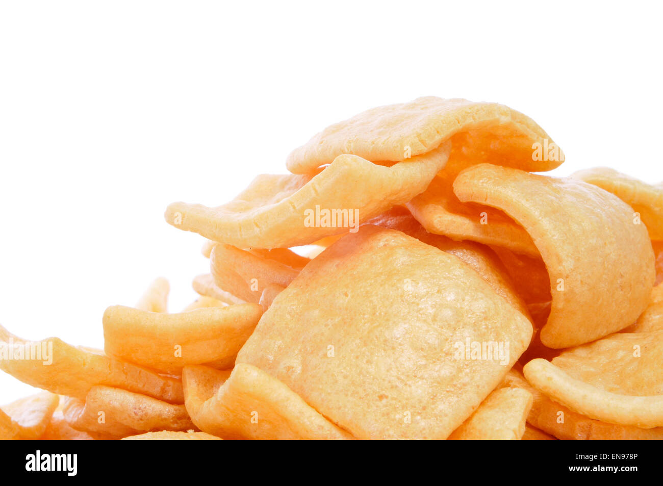 a pile of wheat snacks on a white background - Stock Image