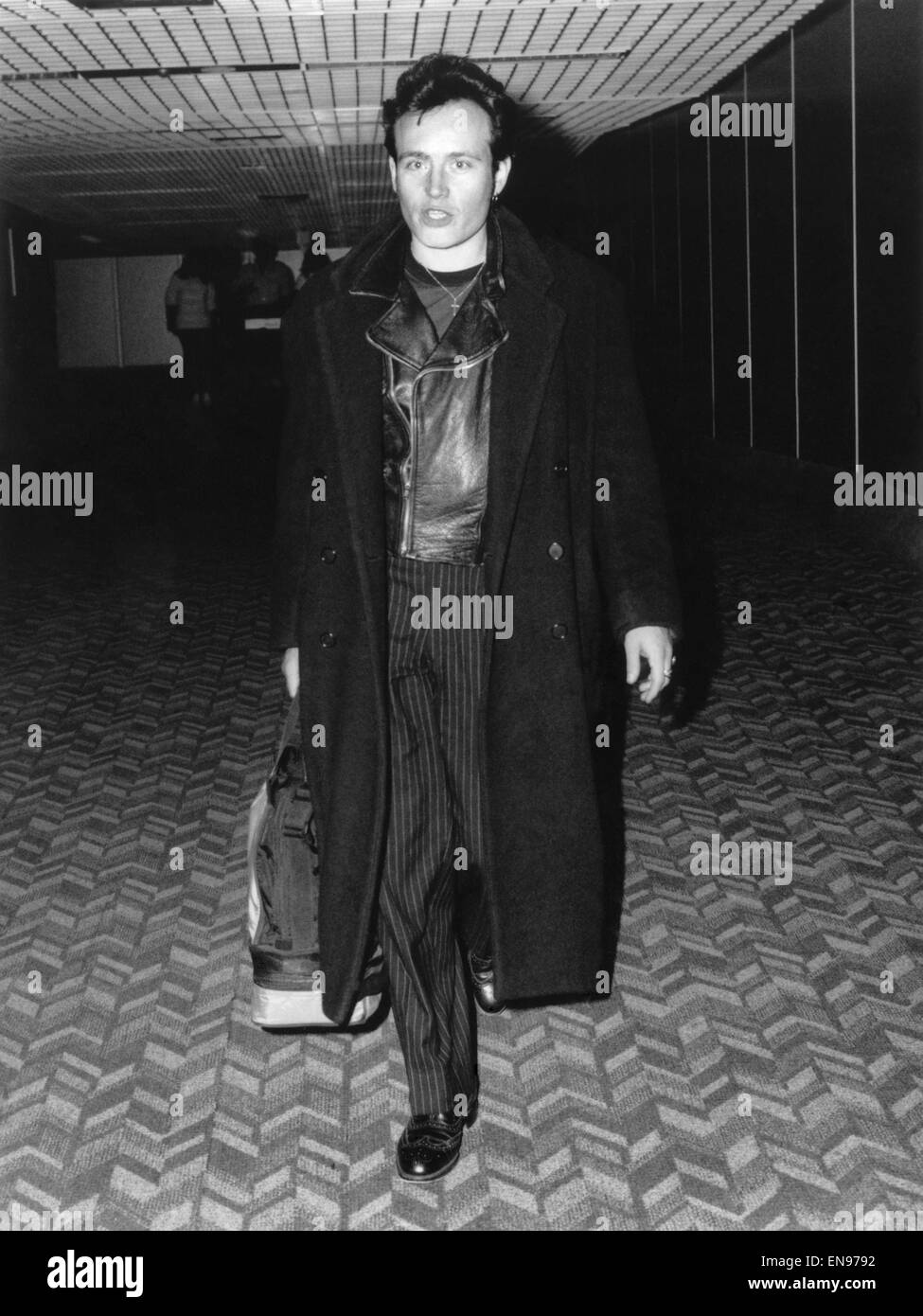 Former pop idol Adam Ant flew home to Britian yesterday to make a comeback as a singer. Adam, who has been working - Stock Image