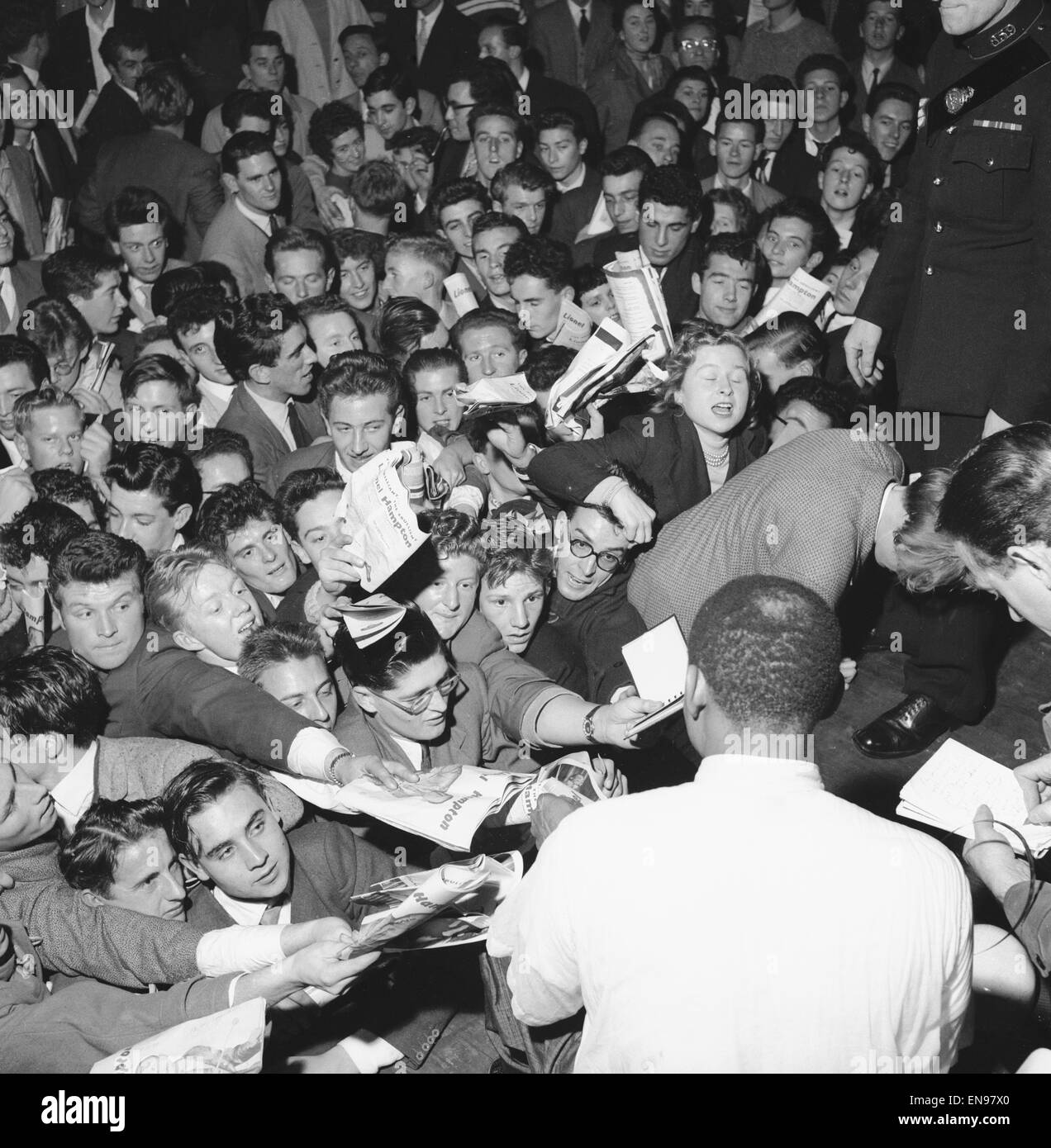 Fans rush forward to get the autograph of jazz legend Lionel Hampton at the Empress Hall, London. 21st October 1956 - Stock Image