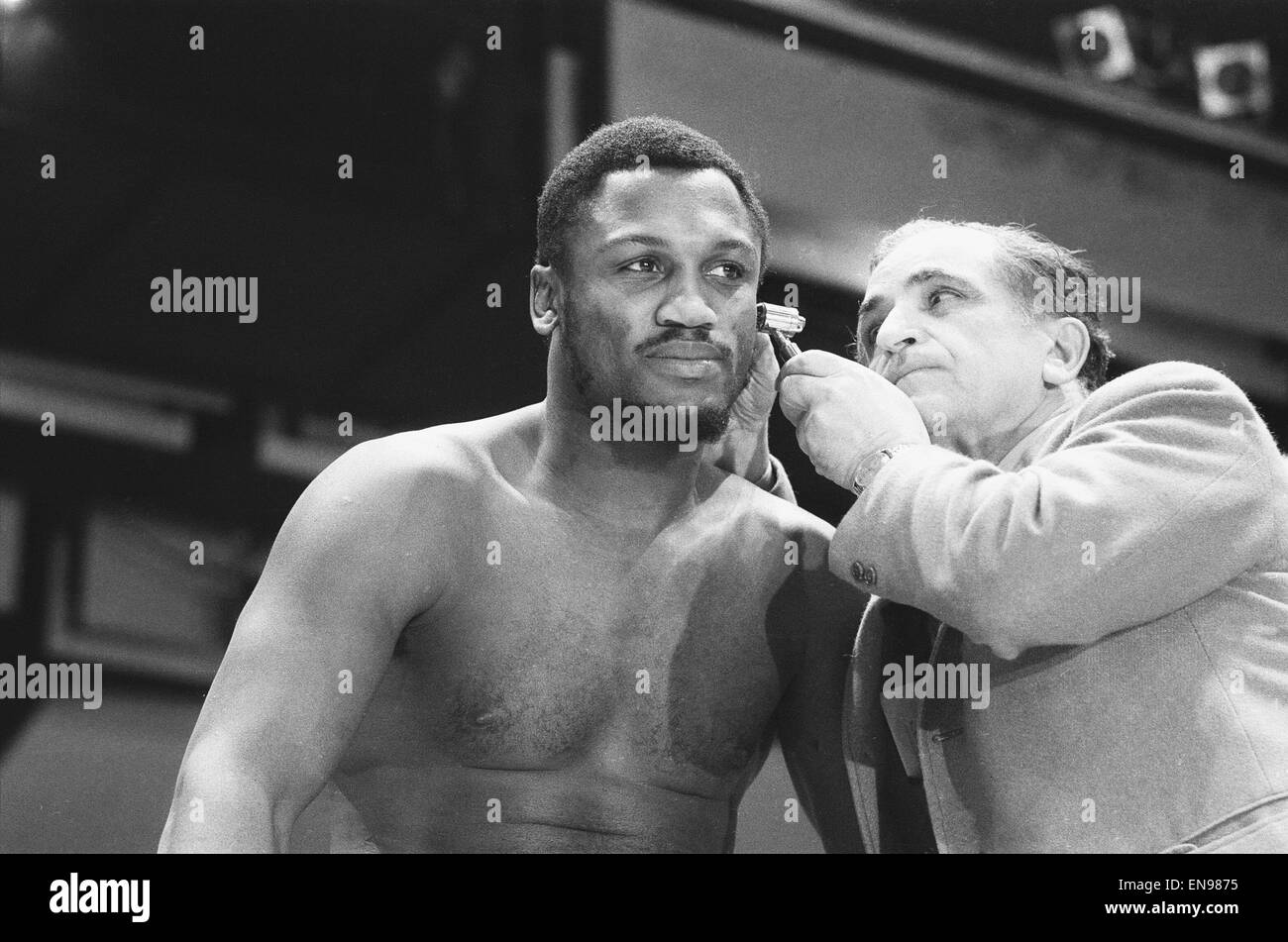 World Champion Joe Frazier (left) seen here being examined at the pre fight medical for his bout against Mohammad - Stock Image