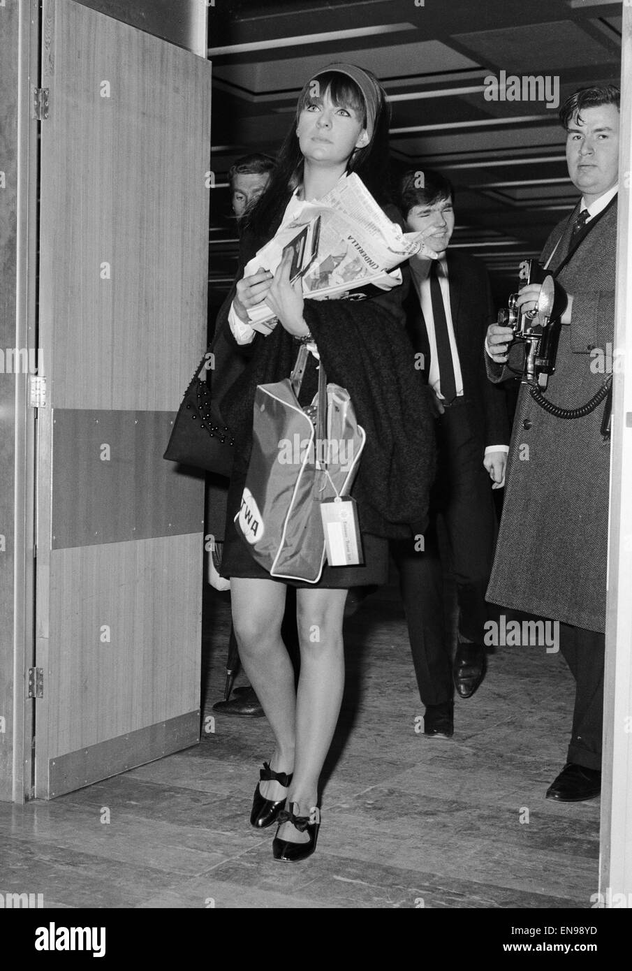 Chrissie Shrimpton, girlfriend of Mick Jagger of The Rolling Stones, flying out to join him at the end of their Stock Photo
