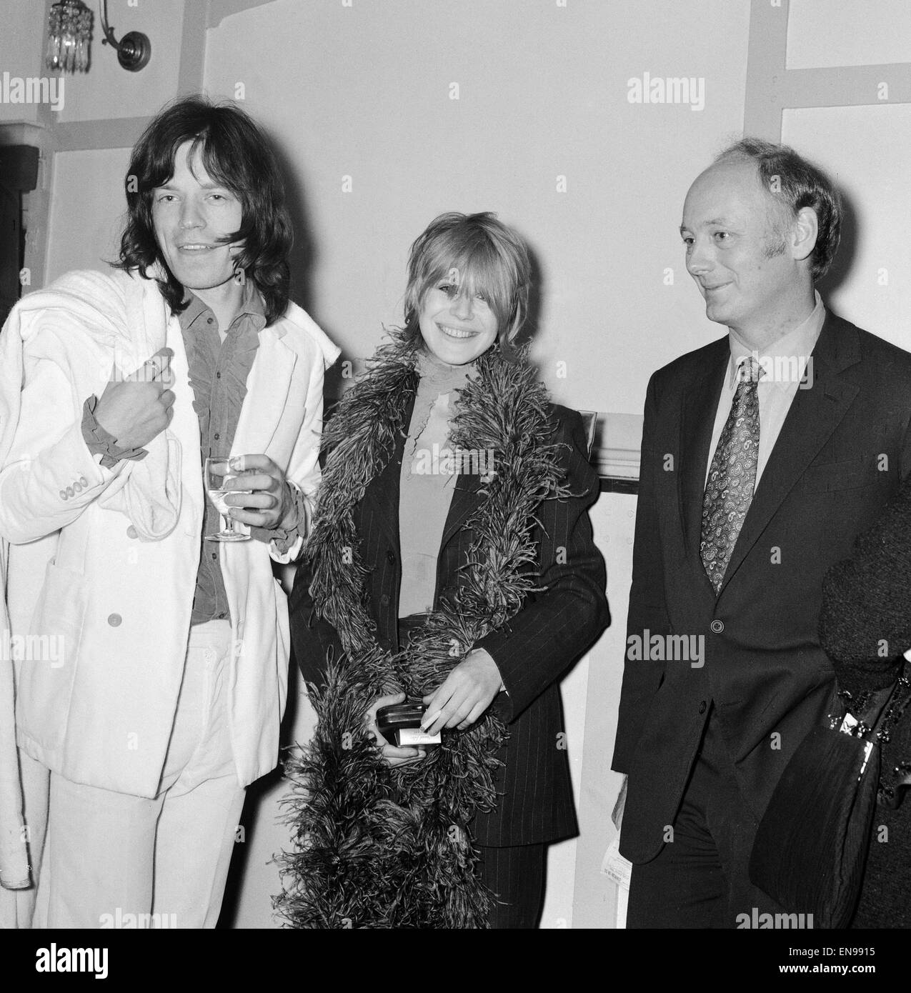 Mick Jagger and Marianne Faithfull talking to Lord and Lady Montagu at the premiere of the musical 'Hair'. - Stock Image